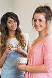 Smiling women holding coffee cups