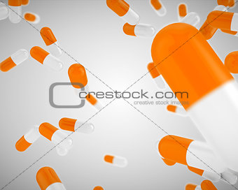 Floating orange pills