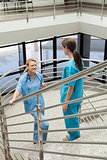 Two nurses standing opposite each other in the stairwell