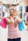 Happy woman in clothes shop