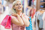 Woman laughing in clothes shop