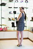 Woman standing at shoe display