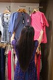 Woman looking through clothes rail