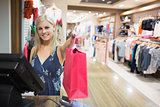 Smiling woman holding shopping bag