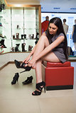 Woman sitting trying on shoes