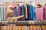 Woman looking at a clothes rack showing clothes