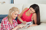 Two women looking at magazine