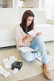 Woman checking bills in the living room