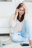 Woman on the phone getting stressed over bills