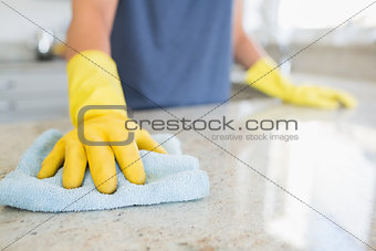 Woman cleaning the counter