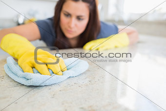 Woman wiping counter