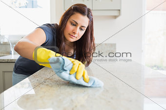 Concentrated woman scrubbing the bar