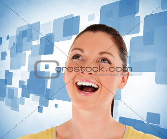 Woman looking up against blue background