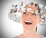 Woman viewing pictures around her head