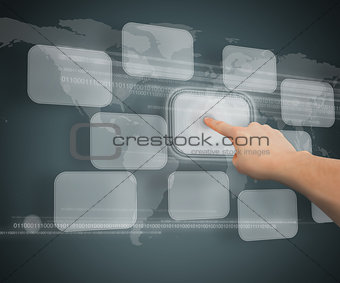 A finger touching button against grey background