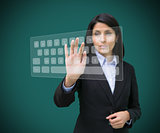 Businesswoman touching projected digital keyboard