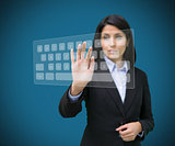 Businesswoman typing on projected digital keyboard