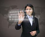 Businesswoman typing on projected digital keyboard