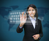 Woman touching digital keyboard against blue background