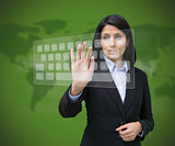 Woman touching digital keyboard against green background