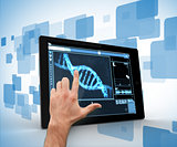 Man touching tablet pc with DNA interface