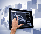 Man pointing at DNA interface on digital tablet
