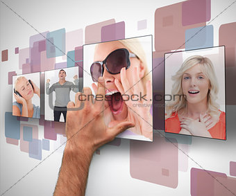 Male hand selecting photo from digital wall