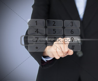 Business woman entering pin on digital number pad