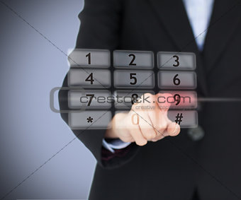Woman pressing number on digital number pad