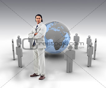 Businessman standing in front of a blue globe with stick figures