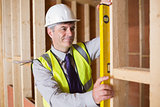 Architect measuring wood frame
