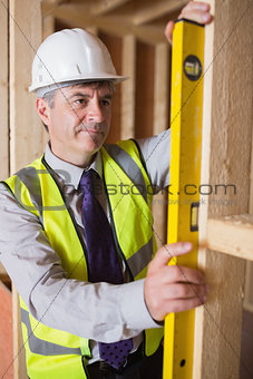 Man measuring wooden frame