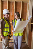 Woman and man discussing blueprints
