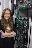 Girl standing beside rack mounted servers