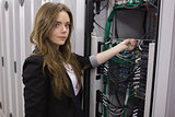 Girl working on mounted rack servers