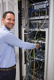 Smiling man adjusting server