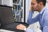 Man running diagnostics of servers