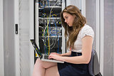 Female technician doing data storage