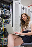 Woman with laptop doing data storage