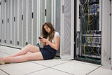 Woman texting next to the servers