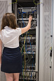 Woman fixing server wires