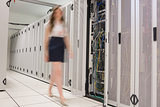 Woman walking through data center