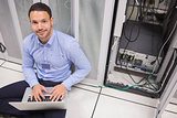 Man smiling while doing server maintenance