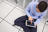 Man with tablet pc in data center