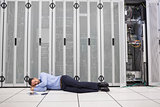 Man sleeping in front of servers