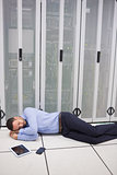 Technician sleeping in front of servers