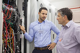 Two technicians discussing wiring