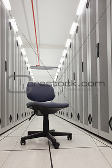 Chair in empty row of servers