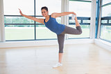 Smiling woman doing yoga pose
