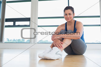 Smiling woman sitting on the floor